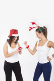 Two Santa Girls making gifts for Christmas holiday Stock Images