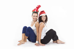 Two Santa Girls making gifts for Christmas holiday Stock Photo