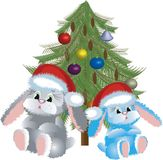 Two Santa-hares Stock Photography