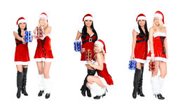 Two santa woman and christmas balls in box Royalty Free Stock Photos