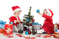 Two santas girls Stock Photo