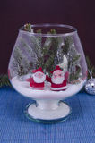 Two Santas in a glass bowl covered with snow Stock Photos