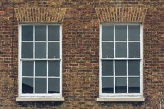 Two Sash Windows in Brick Wall. Split Toning Shallow Depth of Field Architecture Details Stock Images