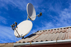 Two satellite dish on roof. Two white satellite dish on the roof Royalty Free Stock Photography