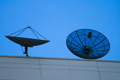 Two Satellite dish at sunset Stock Photo