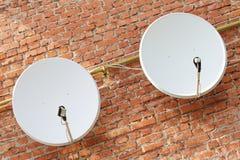 Two satellite dishes Stock Photos