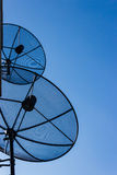 Two satellite dishes Royalty Free Stock Images