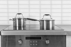 Two saucepans on electric stove. In kitchen Royalty Free Stock Photos