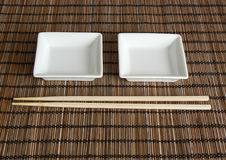 Two saucers and chopsticks  Royalty Free Stock Images