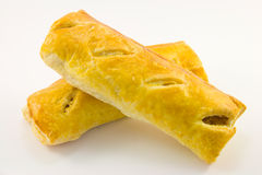Two Sausage Rolls. Two golden sausage rolls on a white background Royalty Free Stock Image