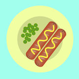 Two sausages and peas on a plate Stock Photo