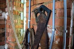 A two saws on a brick wall royalty free stock images