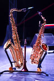 Two saxophones on stage Stock Image