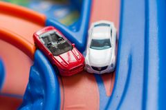 Two scale model toy cars accident on the road. Traffic jam. Stupidity. Royalty Free Stock Photography