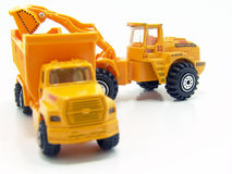 Scale model construction vehicles. Isolated photo of two scale model vehicles, a truck and a tractor loader that give kids hours and hours of fun Royalty Free Stock Photos