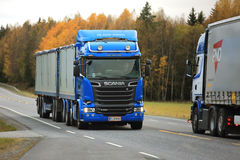 Two Scania Trucks Meet on the Road Stock Image