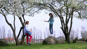 Two school girlfriend rehearsed performance, play mini orchestra in nature, concept fun to spend time with friends. Two school girlfriend rehearsed performance stock video