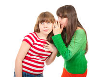 Two school girls whisper. About handsome guy royalty free stock images