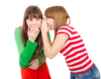 Two school girls whisper. About handsome guy stock photo