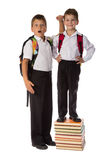 Two schoolboys standing with pile of books Royalty Free Stock Image
