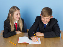 Two schoolchildren doing homework Royalty Free Stock Image