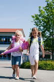 Two schoolchildren having fun Stock Image