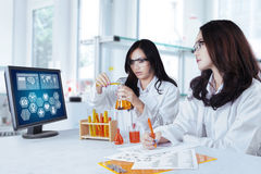 Two schoolgirls doing research in lab Royalty Free Stock Images
