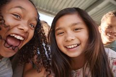 Two schoolgirls and friends smiling to camera, close up royalty free stock photos