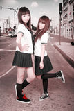 Two schoolgirls outdoors. Royalty Free Stock Photos