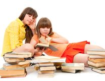 Two schoolgirls read many books Stock Photos