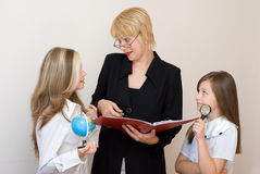 Two schoolgirls with teache Royalty Free Stock Image