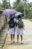 Two schoolgirls walking in the street, Negombo, Sr Royalty Free Stock Photography
