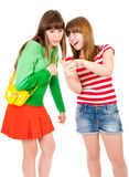 Two schoolgirls watching something in the mobile Stock Images