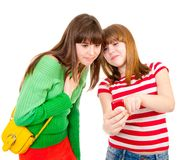 Two schoolgirls watching something in the mobile Stock Image