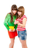 Two schoolgirls watching something in the mobile. Phone isolated Royalty Free Stock Photo