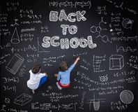 Two schoolkids learning Stock Images