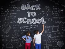 Two schoolkids learning Royalty Free Stock Photos