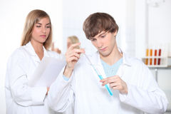 Two science students Stock Image