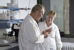 Two science technicians stock image