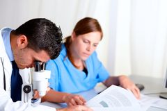 Two scientific colleagues working at laboratory Stock Photo
