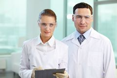 Two scientists. Portrait of two scientists looking at camera and smiling stock photo