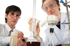 Two scientists  with chemical equipment Stock Images