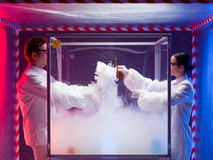 Two scientists conducting tests in sterile chamber Stock Images
