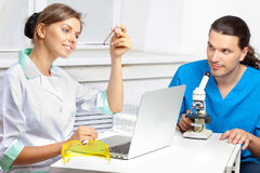 Two scientists develop a new remedy Stock Photo