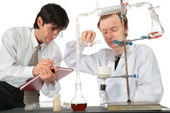 Two scientists do chemical experiment Stock Photos