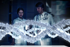 Two scientists in laboratory. Young scientists looking at DNA molecule image at media screen Stock Photos