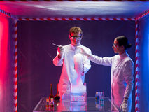 Two scientists mixing chemicals in lab Stock Photos