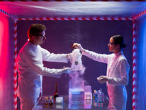 Two scientists mixing chemicals in a laboratory Stock Photos