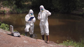 Two scientists taking water samples from a river Stock Image