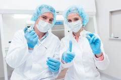 Two scientists with tools posing in the lab Royalty Free Stock Photos